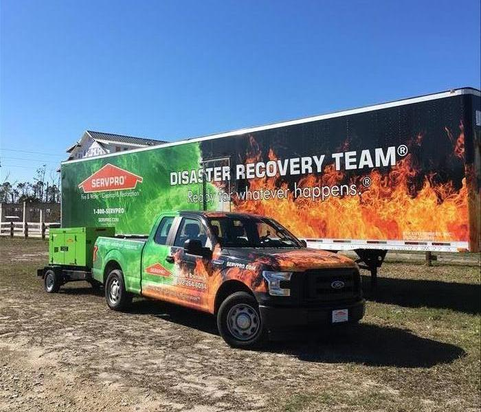 SERVPRO semi truck and pick up truck.
